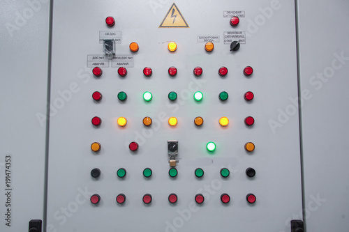 Buttons and switches on panel. Gray panel with colorful buttons