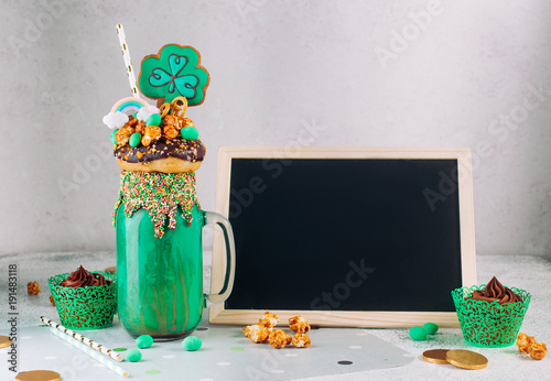 Aluminium Milkshake Freak shake topping with clover cookie on grey background with chalkboard desk