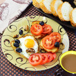 Food, breakfast. In the morning on the table prepared eggs, toast, tomatoes, pickled mushrooms, cocoa, baguette and black olives. - 191483585