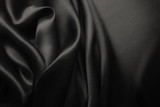 Elegant black satin silk with waves, abstract background