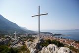 White Christian cross symbol in mountains - 191497554