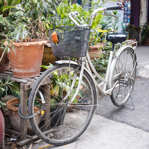 Fotobehang Fiets Bicycle with basket is parked in street