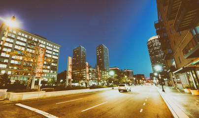 BOSTON, MA - OCTOBER 17, 2015: City streets at night. Boston is visited by 15 million tourists every year