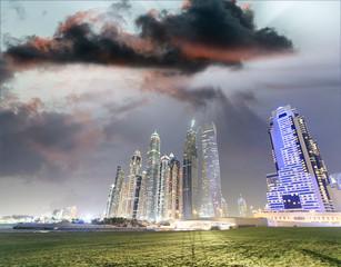 Dubai Marina night view of city skyscrapers from a park