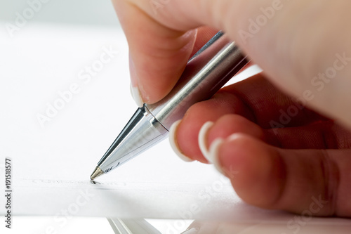hand with fountain pen at signature