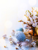 Happy Easter;  Easter eggs and sprig flowers on blue table background - 191526179