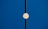 Antique Street Lamp Against A Blue Sky - 191532734
