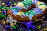 king cake surrounded by mardi gras decorations - 191540328