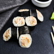Japanese sushi rolls maki on the graphite board