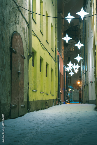 Foto op Canvas Smal steegje Riga Old town in winter covered with snow. Historical buildings, popular landmarks, authentic architecture. Small streets with cobblestone.