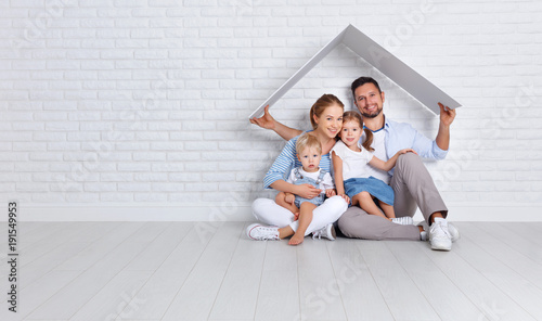 concept housing a young family. mother father and children in  new home.