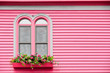 Arched Windows on a Colorful Pink House with Flower Boxes