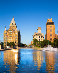 Downtown Syracuse New York with view of historic buildings and fountain at Clinton Square