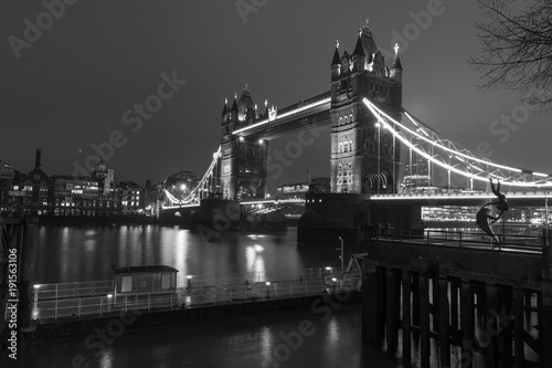 Papiers peints Londres Tower bridge and dolphin statue at night with sepia filter, London, England