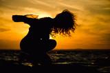 feminine silhouette on sunset background - 191579162