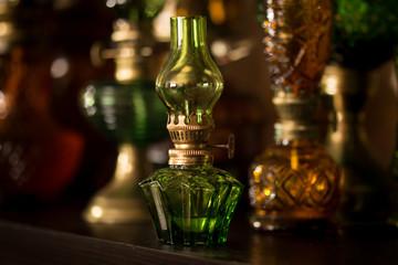 Small green kerosene lamp