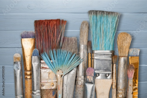 Artist paint brushes and paint cans