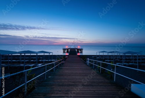 pier at dawn, view from the shore