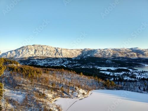 Foto op Plexiglas Pool Sunny days in Finnmark Northern Norway indian summer first snow