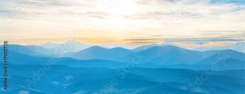 Keuken foto achterwand Panoramafoto s Blue mountains at sunset sky. Panorama view of peaks ridge