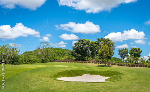Fotobehang Gras The sand Bungker in golf course with blue cloud sky background