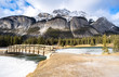 Breathtaking view of Cascade Mountain, Rocky Mountains, Canada, seen from park and quaint bridge