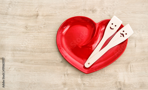 Wall mural Red heart plate wooden kitchen utensils Funny tools food
