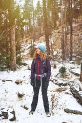 a young woman backpacking in the snow in the Rocky Mountains.
