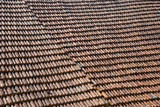 A large expanse of rustic French roof tiles, full frame construction background texture - 191670126