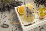 Lavender  tea with honey and lemon on the white  wooden  tray - 191674540
