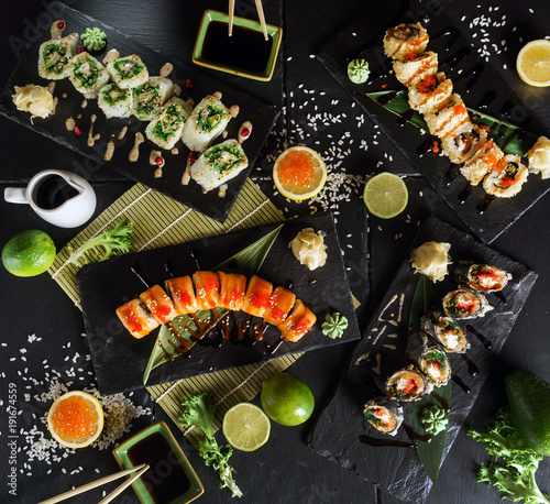 Tuinposter Sushi bar sushi on the black background