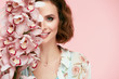 Beauty Makeup. Beautiful Woman Face With Flowers