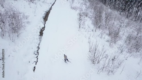 View from the heights to the skier descending the ski slope
