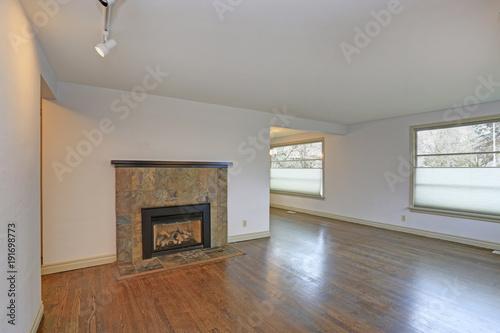 Large empty living area with hardwood floor