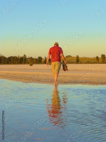 Fotobehang Strand Man Salt lake Rockingham