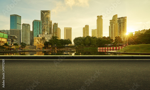 Staande foto Kuala Lumpur Asphalt road side with beautiful Kuala Lumpur city waterfront skyline. Sunrise scene .