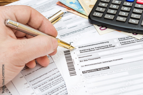 Man filling German tax form.