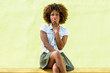 Quadro Black woman, afro hairstyle, sitting with a surprise face