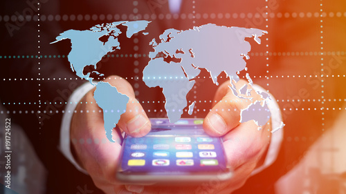 Foto Murales Businessman using a smartphone with a Connected world map - 3d render