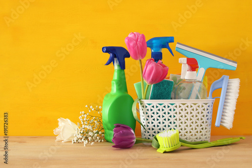 Spring cleaning concept with supplies on wooden table. - 191726383