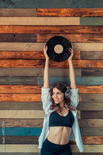 Fotobehang Muziek Young girl with headphones