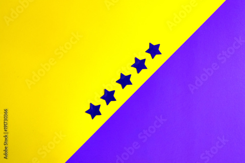 Foto op Canvas Pop Art ultaviolet stars on a yellow and ultraviolet background