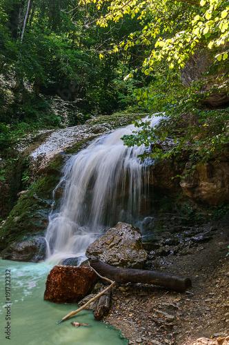 Fotobehang Bergrivier waterfall on a mountain stream