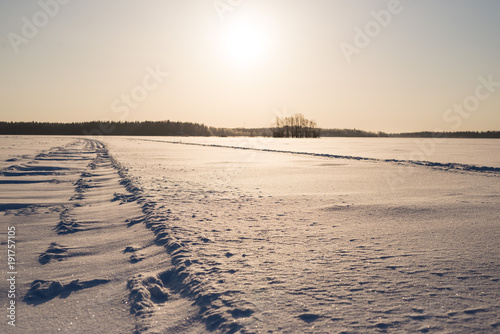 Foto op Aluminium Beige Sunny Day on Snowy Lake Ice, focus on foreground