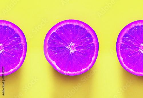 Surrealism. Violet oranges on yellow background