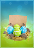 Painted Easter eggs with feathers in the nest and postcard for congratulations on green-blue blurred background - 191762961