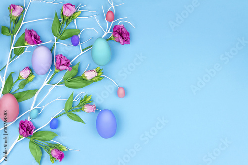 Foto Murales Happy Easter concept. Blue branch tree with colorful spring's flowers and colorful easter eggs on blue background