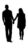 Silhouette of a couple walking together and holding hands