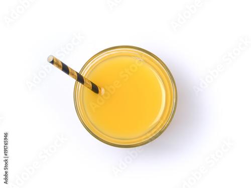Orange juice glass with straw