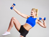 Fit woman lifting dumbbells weights - 191767178